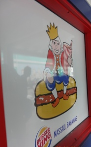 A Burger King restaurant, complete with a wig-wearing mascot, in Nassau, The Bahamas.