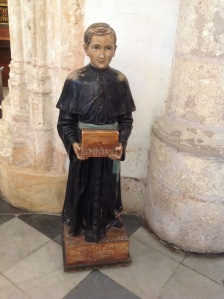 A wooden figure collecting donations in Santo Domingo's Cathedral of Santa Maria la Menor, the oldest cathedral in the Americas.